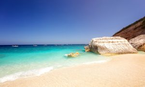 a picture of rocks on the beach of cala mariolu near cala gonone in east sardinia