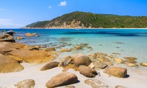 a picture of some rocks scattered around the beach of Cala Pira in south-east Sardinia