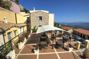 a picture of the outdoor terrace at Bia Maore, a three-star hotel in Baunei, east Sardinia, Italy.