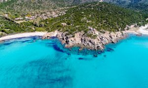an aerial picture of perda longa beach near chia in south sardinia, italy.