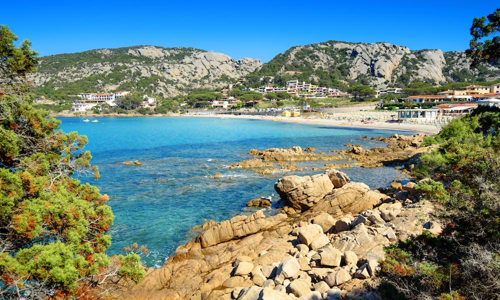 a picture of the beach at Baia Sardinia near Porto Cervo in Sardinia Italy.