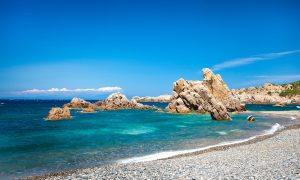 a picture of rocks in the water at tinnari beach in north sardinia