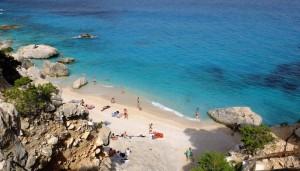 a picture of su portu beach in chia sardinia
