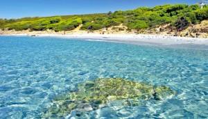 a picture of su portu de su trigu beach in sant'anna arresi sardinia