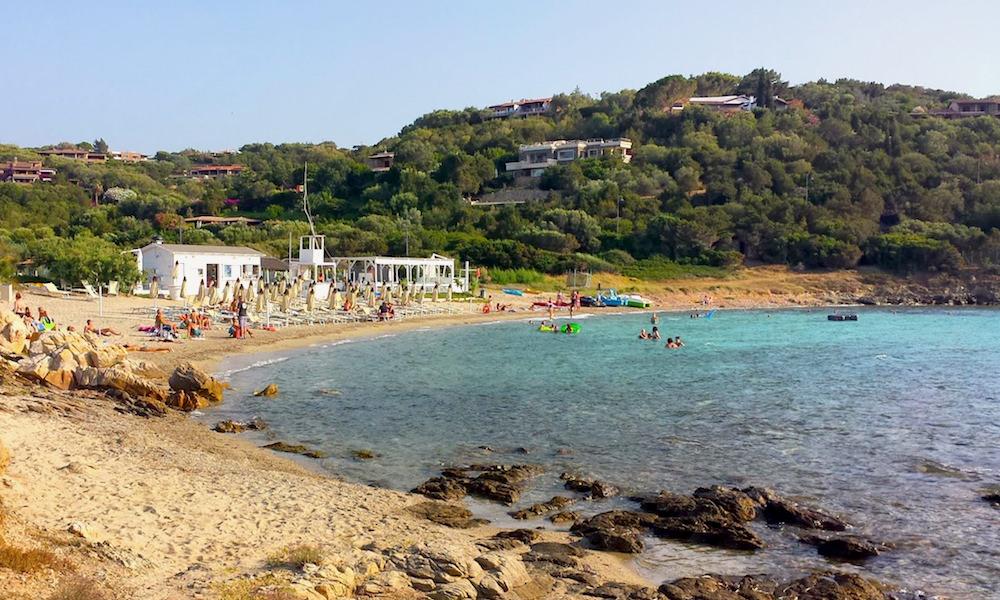 a picture of spiaggia dei sassi in porto rotondo sardinia