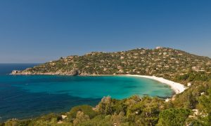 a picture of the beach at torre delle stelle in south sardinia italy