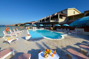 a picture of the sun terrace and outdoor pool at Hotel Corallo in Isola Rossa, north Sardinia, Italy.