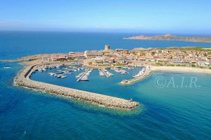 an aerial picture of the harbor in Isola Rossa, north Sardinia, Italy.