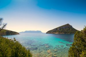 a picture taken at Cala Moresca, with views of Isola Tavolara and Isola di Figarolo, in Golfo Aranci, north-east Sardinia, Italy.
