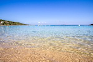 a picture of the shallow and clear waters at Cala Tremonti, a small beach near Baja Sardinia on the Costa Smeralda, north-east Sardinia, Italy.