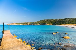 a picture of a boardwalk on the north side of La Marmorata, a beach near Santa Teresa di Gallura, north Sardinia, Italy.