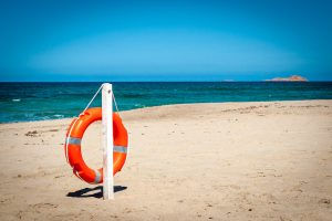 a lifebuoy on the beach of Li Junchi, in Badesi, north Sardinia, Italy.