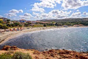 a summer day on a beach near Isola Rossa, in north Sardinia, Italy.