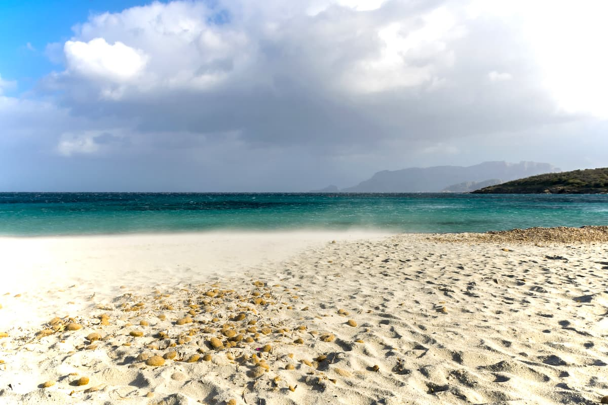 the white and fine sands of the beach named Spiaggia di Bados, in Pittulongu, north-east Sardinia, Italy.