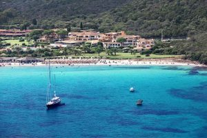 stunningly blue water and a white sandy beach at Hotel Abi d'Oru, Golfo di Marinella, Emerald Coast, Sardinia. Italy.