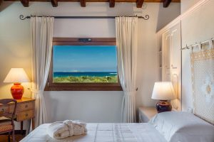a hotel room with fantastic views of the sea in Golfo di Marinella, Costa Smeralda, north-east Sardinia, Italy.