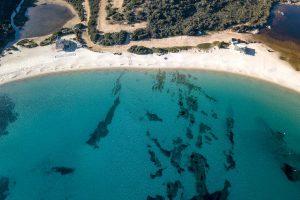 an aerial view of Spiaggia Bianca near Golfo Aranci, Sardinia, Italy.