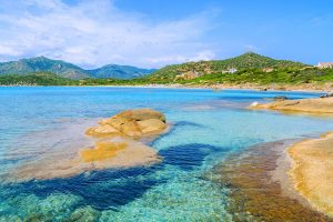 a sweeping view of Spiaggia di Campulongu in Villasimius south-east Sardinia Italy.
