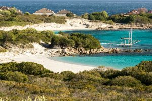 Two Sardinian beaches named Spiaggia Cala Banana and Spiaggia di Nodu Pianu, near the village of Pittulongu, in north-east Sardinia, Italy.