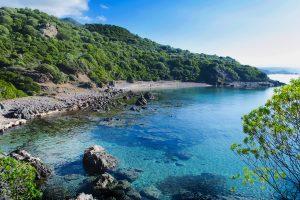 the beach named Spiaggia di Porto Mànagu near the medieval village of Bosa, in west Sardinia, Italy.